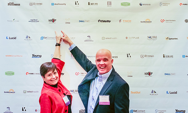 ARUP CEO Sherrie Perkins and President Andy Theurer indicate ARUP in a list of award winner