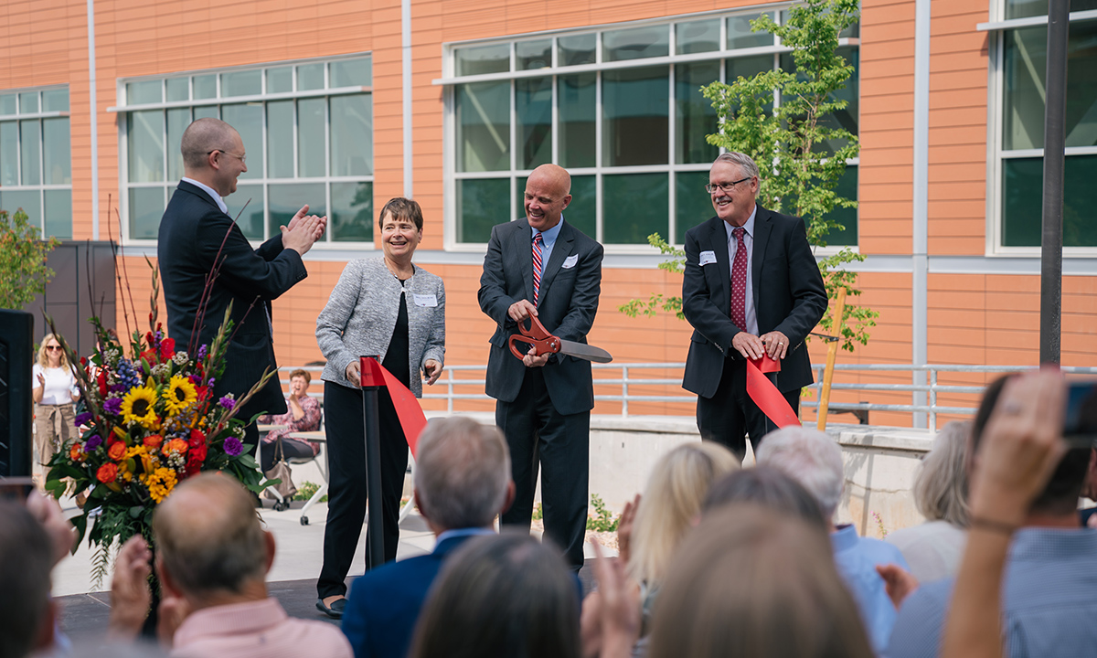 Jonathan Genzen, Sherrie L. Perkins, Andy Theurer, and Peter Jensen cut a red ribbon to officially open ARUP's new laboratory facility.