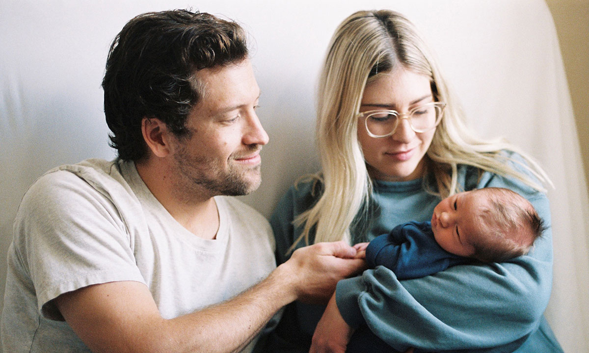Stew and Becky Tribe hold their newborn son
