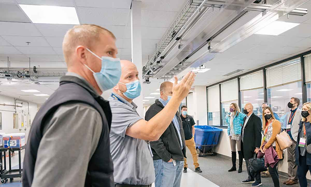 Zachary Wilkey explains features of ARUP's laboratory automation system to members of the Association of University Research Parks (AURP) during a tour.